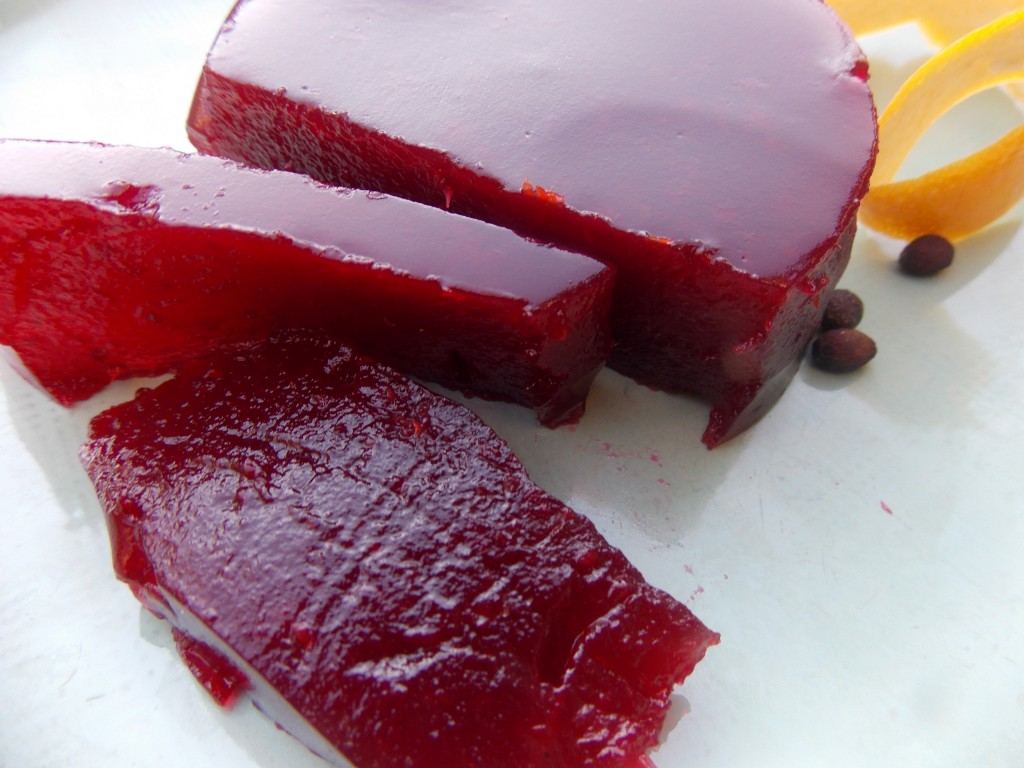 Homemade jellied cranberry sauce with spicebush and orange